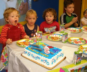 hart-blowing-out-candles-at-bouncing-angels-party