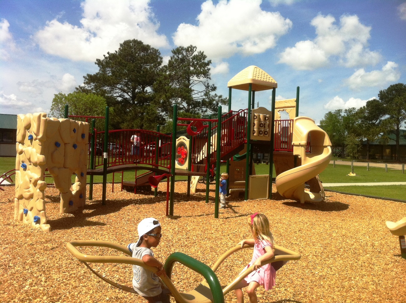 Newly renovated Lake Mayer playground three new climbing structures complete with climbing walls, tunnels; plus new swing sets, new baby swing sets, new mulch, new swivel seat, new twirling toy & oh-so-modern sleek see-saw!