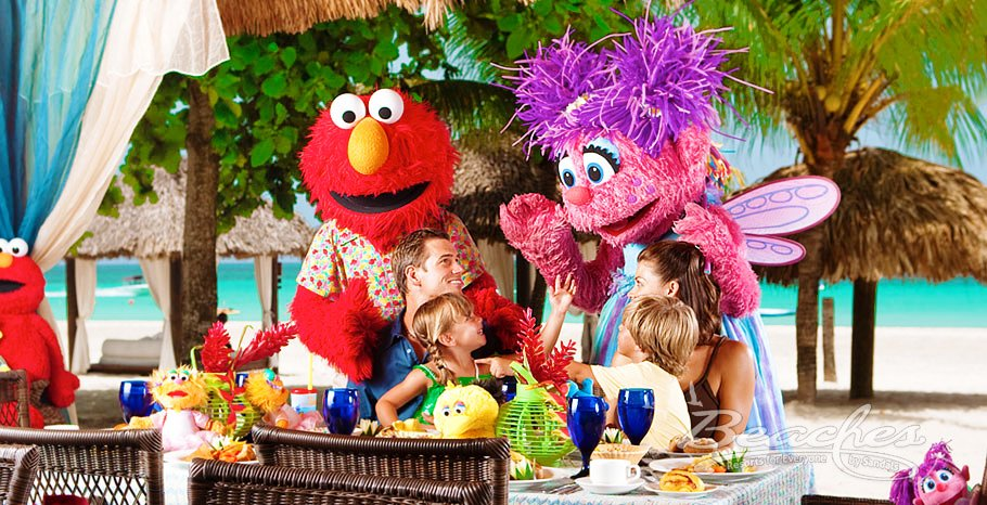 Sesame Street characters at Sandals or  Beaches resorts