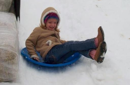 Snow sledding Savannah Madrac Farms