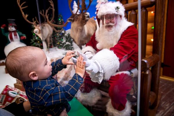 Santa visits in-person Savannah shield